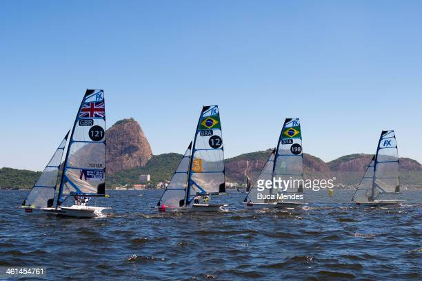 Boats of Finn class race in front of Sugarloaf Mountain during a qualifier for the 2016 Olympics by the Brazil Sailing Cup at Guanabara Bay on...