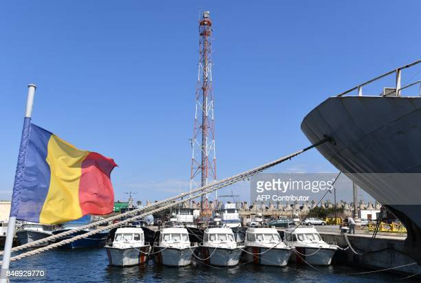 Boats of the Romanian border police are pictured in Constanta southeastern Romania on September 13 2017 Families of migrants landing on European...