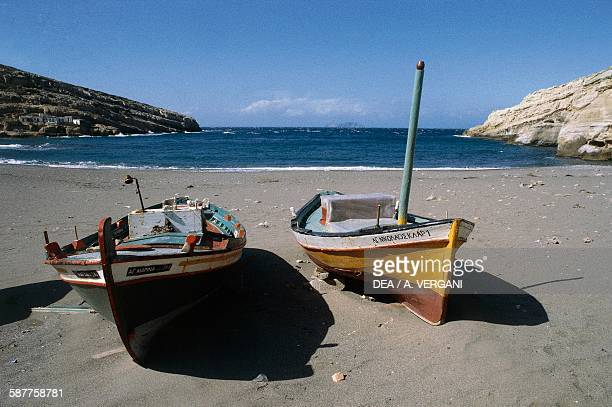 Boats on the beach in the Gulf of Messara Matala Crete Greece