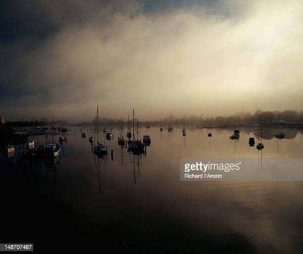 Boats on water of Tamar river at sunrise.