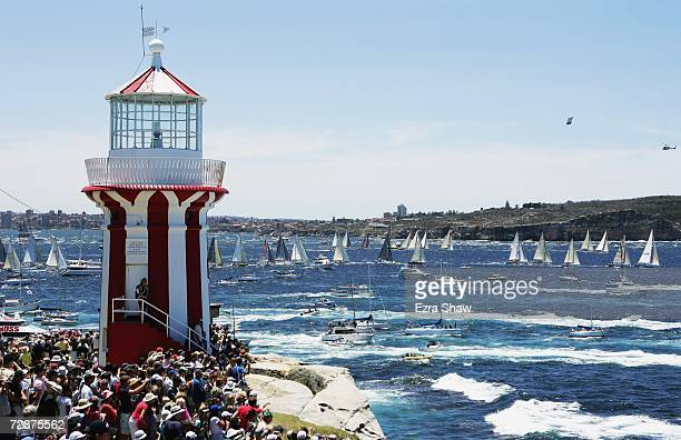 Boats pass the Hornby Lighthouse at South Head during the start of the 62nd Sydney to Hobart yacht race December 26 2006 in Sydney Australia The...