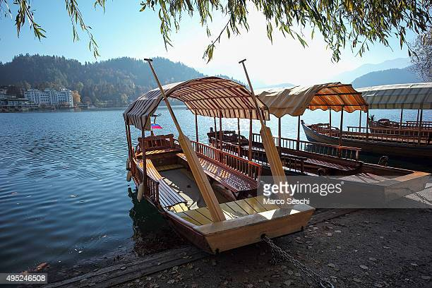 Boats rest on the bank of Bled Lake on November 1 2015 in Bled Slovenia Bled Lake in the Julian Alps is known as one of the most enchanted places in...
