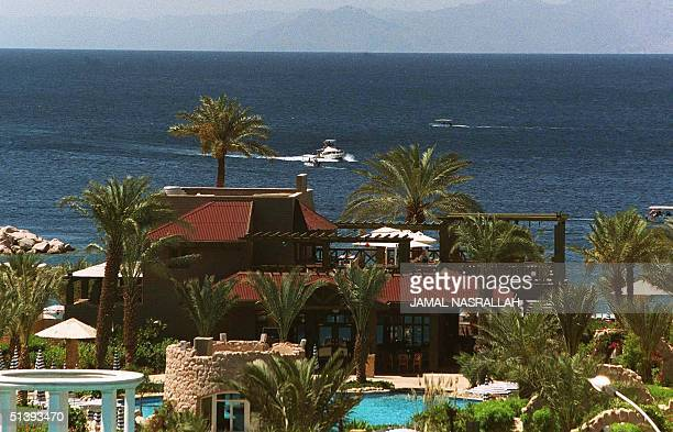 Boats sail past a hotel on the Gulf of Aqaba in the Special Economic Zone of Aqaba 13 April 2001 The Gulf of Aqaba with its large amount of coral and...