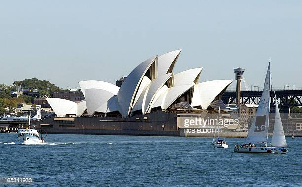 Boats sail past the harbour with a backdrop of the Sydney Opera House 02 April 2005 AFP PHOTO/Rob ELLIOTT