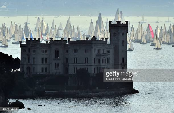 Boats sail past the Miramare castle during the 46th Barcolana regatta near Trieste on October 12 2014 AFP PHOTO / GIUSEPPE CACACE