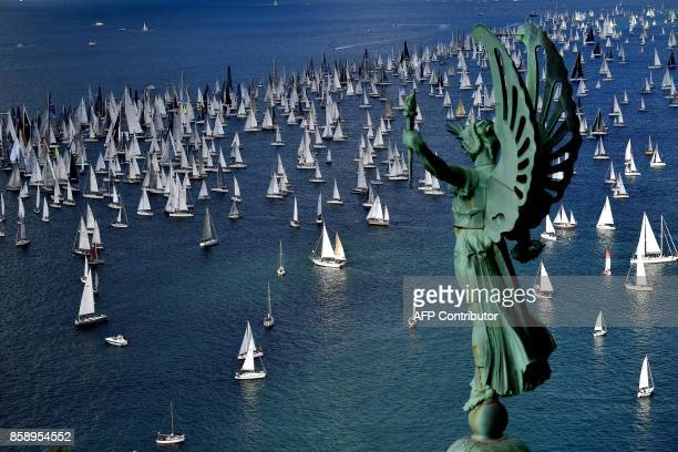 Boats sail past the 'Victory Lighthouse' during the 49th Barcolana regatta in the Gulf of Trieste on October 8 2017 With some 2072 vessels The...
