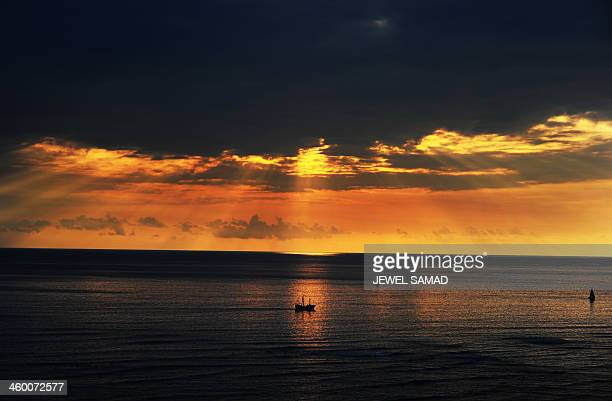 Boats sail the water near Waikiki beach in Honolulu Hawaii on January 1 2014 The First Family is in Hawaii on their annual winter vacation AFP...