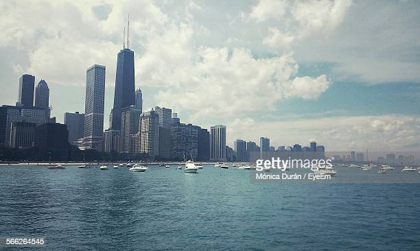 Boats Sailing In Lake Michigan With Cityscape In Background