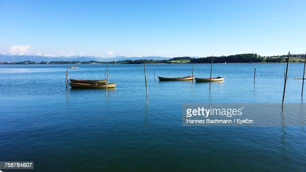Boats Sailing In Sea Against Sky