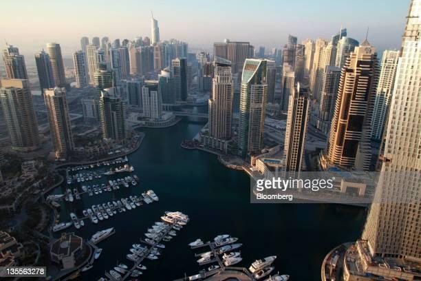 Boats sit at moorings in the harbor area at the Dubai Marina development in Dubai United Arab Emirates on Sunday Dec 11 2011 Dubai and its stateowned...