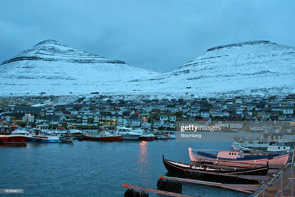 Boats sit in the harbor in Klaksvik, a fishing village in the Faroe Islands, under the sovereignty of Denmark, on Monday, Dec. 3, 2012. A proposed plan would decipher the complete DNA sequence of the 50,000 citizens of this tiny, windswept land halfway between Scotland and Iceland, from its fishermen to the prime minister. Scientists already see the Faroes becoming a model for the use of human genomes. Photographer: John Lauerman/Bloomberg via Getty Images