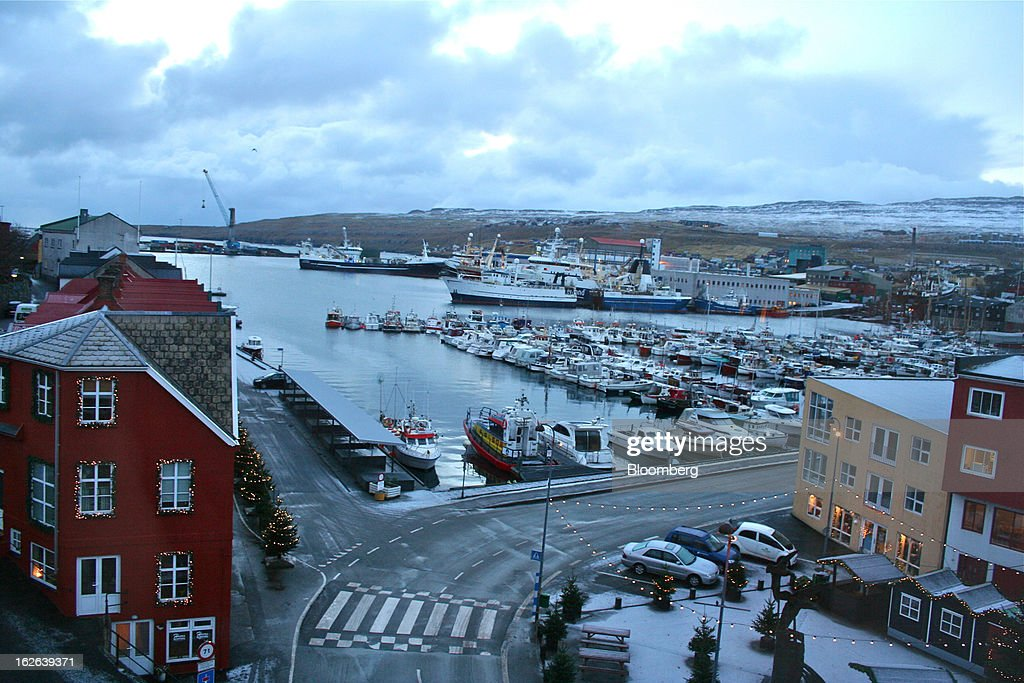 Boats sit in Torshavn Harbor, the largest and busiest harbor in the Faroe Islands, under the sovereignty of Denmark, on Monday, Dec. 3, 2012. A proposed plan would decipher the complete DNA sequence of the 50,000 citizens of this tiny, windswept land halfway between Scotland and Iceland, from its fishermen to the prime minister. Scientists already see the Faroes becoming a model for the use of human genomes. Photographer: John Lauerman/Bloomberg via Getty Images