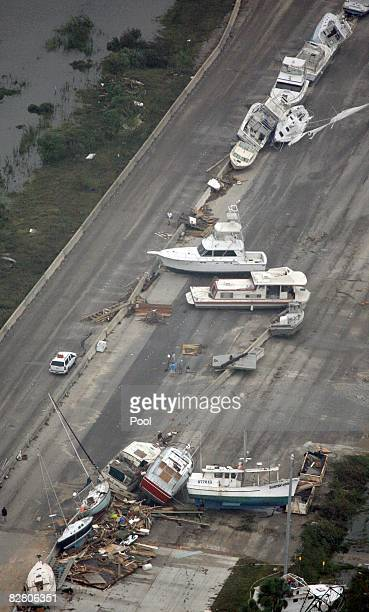 Boats sit on Interstate 45 after Hurricane Ike made landfall overnight September 13 2008 in Galveston Texas Ike caused extensive damage along the...
