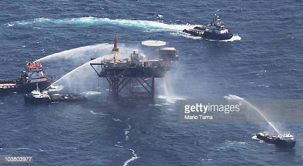 Boats spray water on an oil platform after it exploded in the Gulf of Mexico on September 2 2010 off the coast of Louisiana The 13 crew members were...