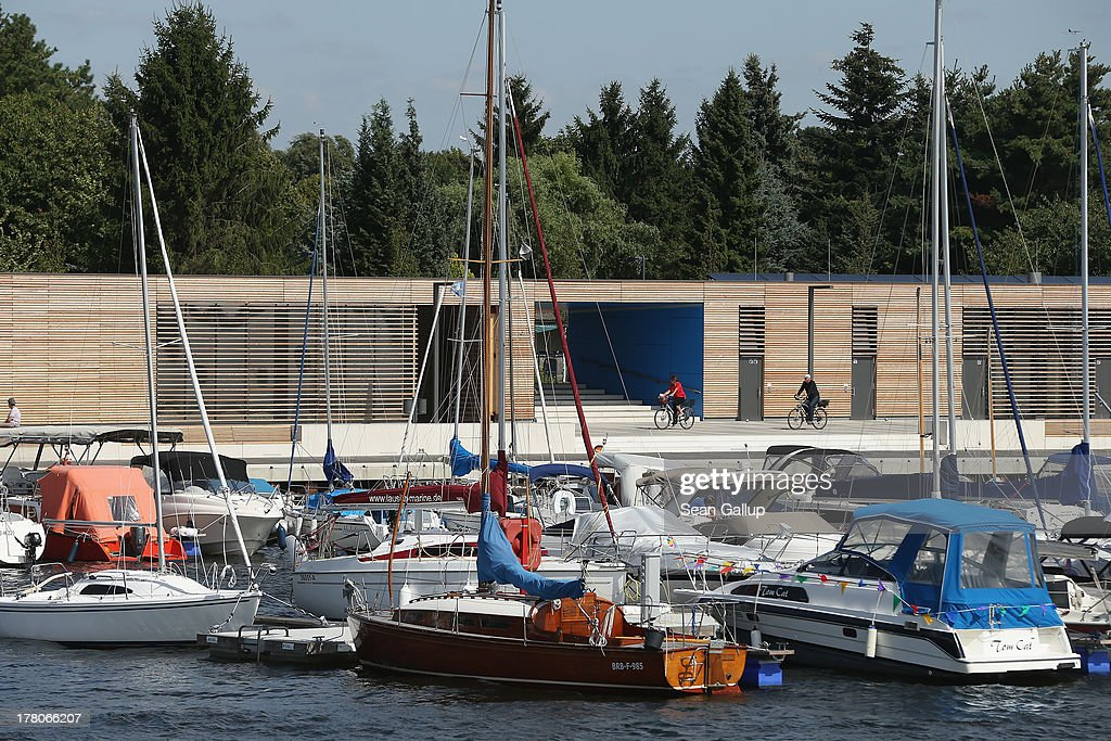Boats stand moored along the boardwalk at the marina of artificial Senftenberger See lake on August 26, 2013 in Senftenberg, Germany. Senftenberger See was once an open-pit lignite coal mine flooded after it shut down in the late 1960s, and today it is popular among tourists, windsurfers and fishermen. In a development project initiated by state government, other nearby former open-pit mines that once evoked a lunar landscape are being turned into lakes in a long-term rejuvenation effort that is also intended to make the area a viable tourist destination. Mineral residue from the mines, however, is proving a difficult stumbling block that is making many of the new lakes too acidic to sustain marine life in the short term.