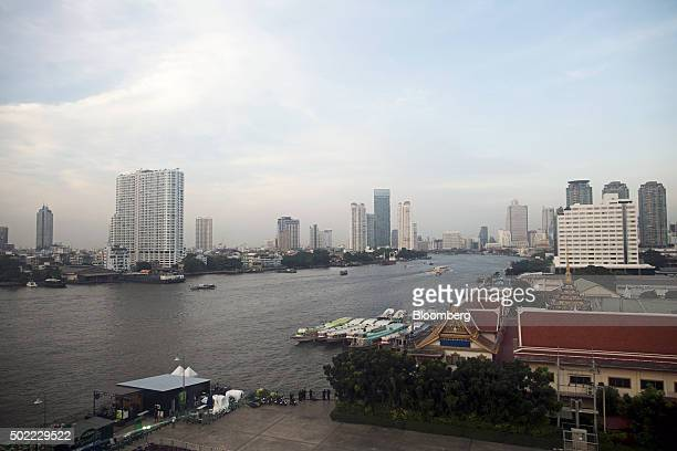 Boats traveling along the Chao Phraya river are seen through the window of a passenger pod on the ferris wheel at Asiatique The Riverfront openair...