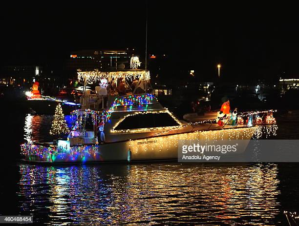 Boats with holiday lights and decorations glide through the Marina del Rey during the Marina del Rey 52nd Boat Parade under the theme of 'Happy...