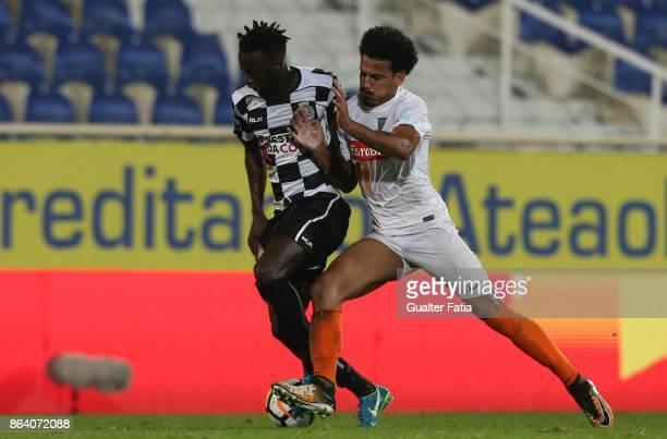 Boavista FC forward Yusupha Njie with GD Estoril Praia midfielder Lucas Evangelista from Brazil in action during the Primeira Liga match between GD...