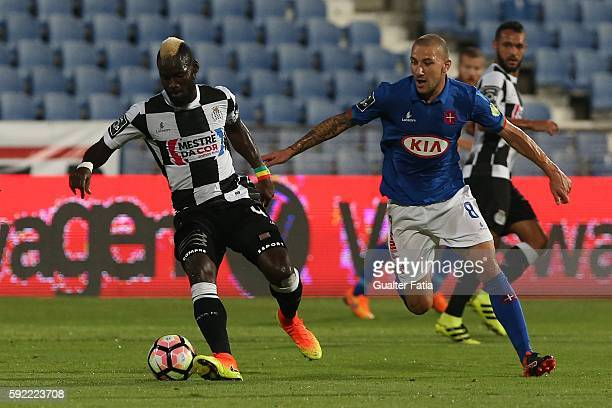 Boavista FCÕs midfielder Idris Mandiang with Belenenses's midfielder Andre Sousa from Portugal in action during the Primeira Liga match between...