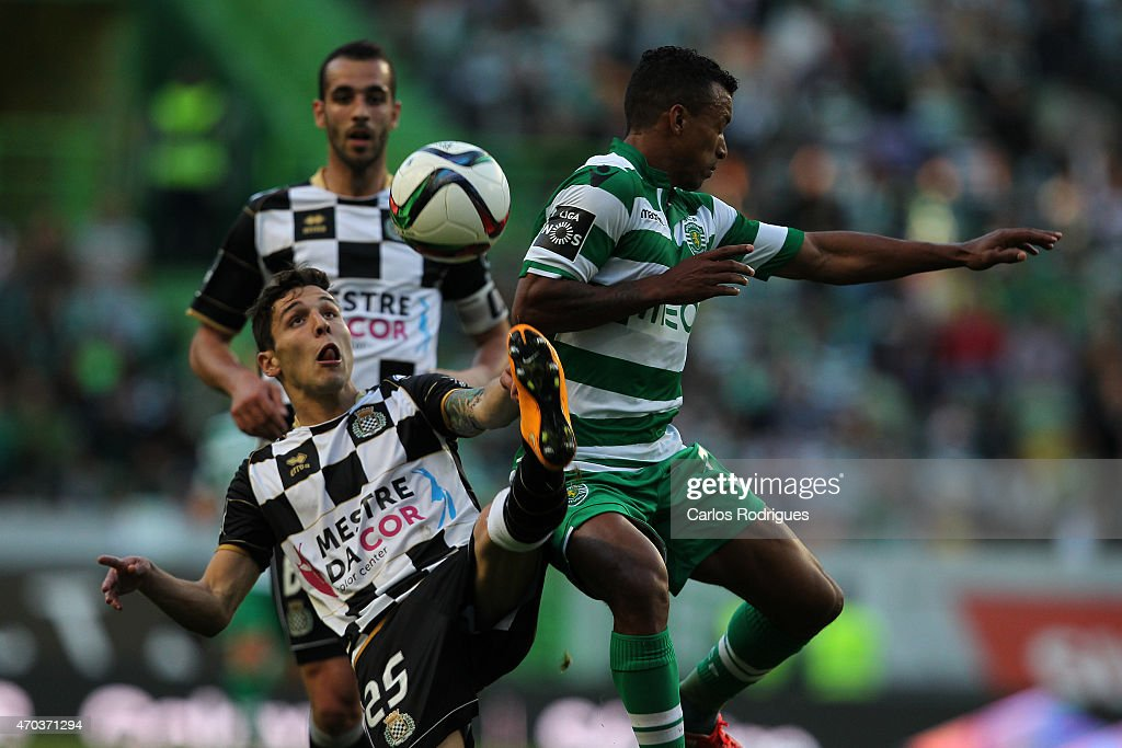 Boavista's midfielder Afonso Figueiredo vies with Sporting's midfielder <a gi-track='captionPersonalityLinkClicked' href=/galleries/search?phrase=Nani+-+Jugador+de+f%C3%BAtbol&family=editorial&specificpeople=11510994 ng-click='$event.stopPropagation()'>Nani</a> during the Primeira Liga match between Sporting CF and Boavista at Estadio Jose Alvalade on April 19, 2015 in Lisbon, Portugal.