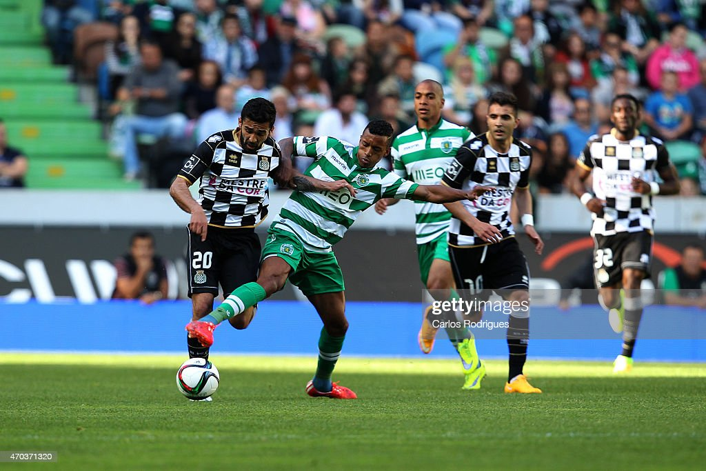 Boavista's midfielder Diego Lima vies with Sporting's midfielder <a gi-track='captionPersonalityLinkClicked' href=/galleries/search?phrase=Nani+-+Soccer+Player&family=editorial&specificpeople=11510994 ng-click='$event.stopPropagation()'>Nani</a> during the Primeira Liga match between Sporting CF and Boavista at Estadio Jose Alvalade on April 19, 2015 in Lisbon, Portugal.