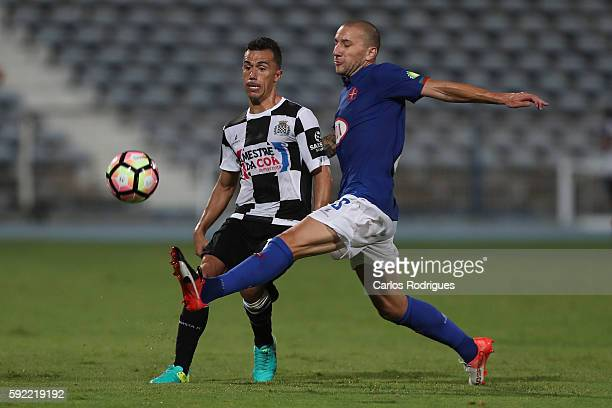 Boavista's midfielder Fabio Espinho from Portugal vies with Belenenses's midfielder Andre Sousa from Portugal during the Portuguese Primeira Liga...