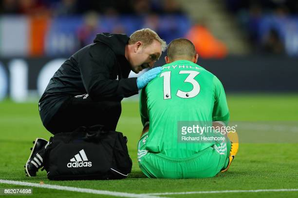Boaz Myhill of West Bromwich Albion lies injured after clashing with Jamie Vardy of Leicester City during the Premier League match between Leicester...
