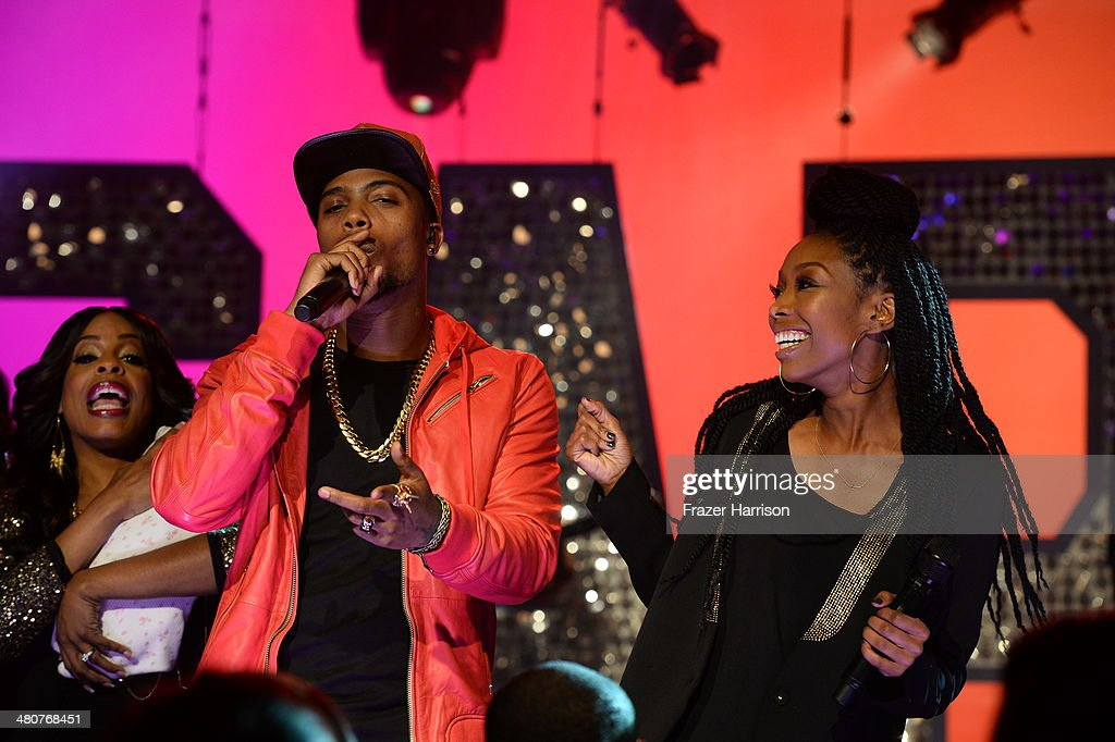 B.o.B. (L) and <a gi-track='captionPersonalityLinkClicked' href=/galleries/search?phrase=Brandy+Norwood&family=editorial&specificpeople=202122 ng-click='$event.stopPropagation()'>Brandy Norwood</a> appear onstage during 'The Soul Man' LIVE! at the CBS Studio Center on March 26, 2014 in Studio City, California.