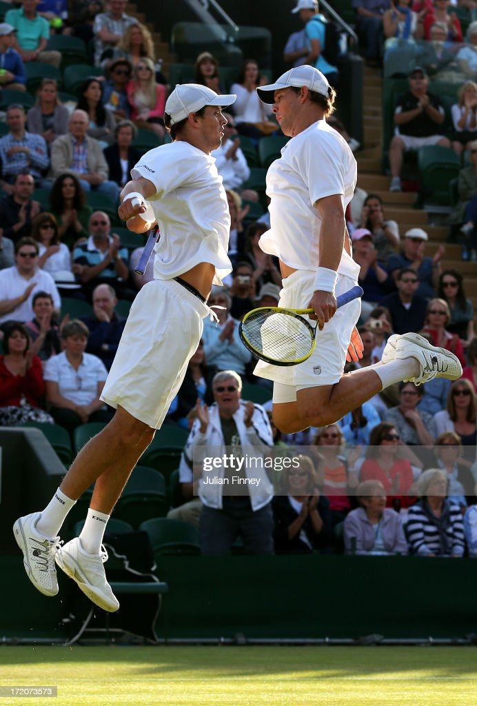 Bob and <a gi-track='captionPersonalityLinkClicked' href=/galleries/search?phrase=Mike+Bryan+-+Tennis+Player&family=editorial&specificpeople=204456 ng-click='$event.stopPropagation()'>Mike Bryan</a> bump chests as they celebrate match point during their Gentlemen's Doubles third round match against Treat Huey of Philippines and Dominic Inglot of Great Britain on day seven of the Wimbledon Lawn Tennis Championships at the All England Lawn Tennis and Croquet Club on July 1, 2013 in London, England.