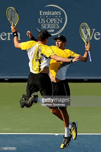 Bob and Mike Bryan celebrate match point against Marcel Granollers and Marc Lopez of Spain during the doubles final of the Western Southern Open on...