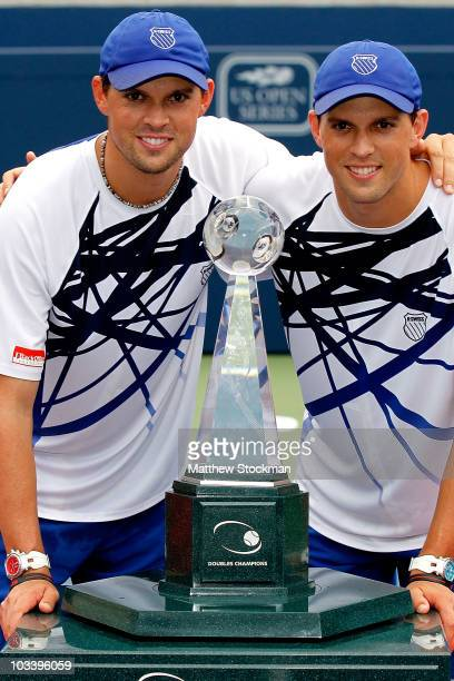 Bob and Mike Bryan of the United States pose for photographers after defeatinf Michael llodra and Julien Benneteau of France in the doubles during...