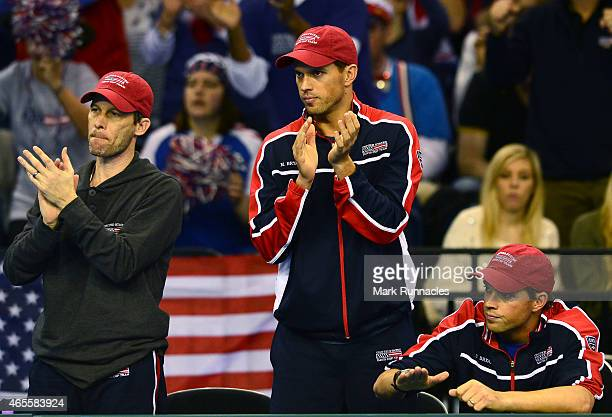 Bob and Mike Bryan of the United States watch on after losing to Team GB during Day 3 of the Davis Cup match between GB and USA at the Emirates Arena...