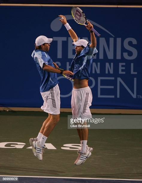 Bob and Mike Bryan of the USA celebrate a point against Jeff Coetzee of South Africa and Rogier Wassen of the Netherlands during their semi final...