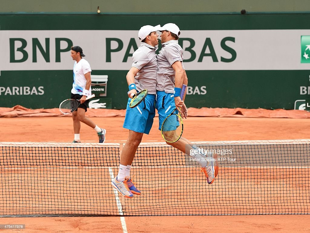 Bob and Mike Bryan of the USA celebrate their win against Jeremy Chardy of France and Lukasz Kubot of Poland at the French Open, Roland Garros Stadium on May 31, 2015 in Paris, France. (Photo by Peter Staples/ATP World Tour/ATP via Getty Images).