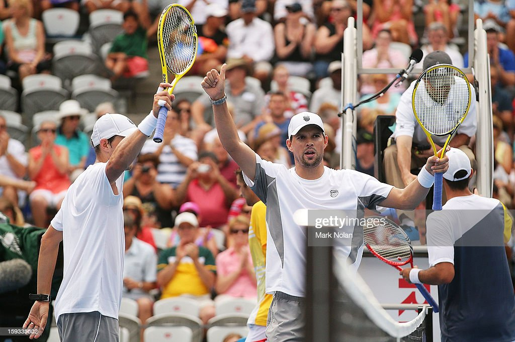 Bob and Mike Bryan of the USA celebrate winning the Mens doubles final against Max Mirnyi of Belarus and Horia Tecau of Romania during day seven of the Sydney International at Sydney Olympic Park Tennis Centre on January 12, 2013 in Sydney, Australia.