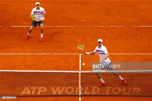 Bob and Mike Bryan of USA in action against Jack Sock of USA and Nick Kyrgios of Australia on day six of the Mutua Madrid Open tennis at La Caja...