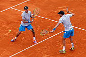 Bob and Mike Bryan of USA in action against Marc Lopez and Marcel Granollers of Spain in the doubles during day six of the Monte Carlo Rolex Masters...