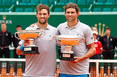 Bob and Mike Bryan of USA with the winners trophies after defeating Simone Bolelli and Fabio Fognini of Italy in the doubles final during day eight...