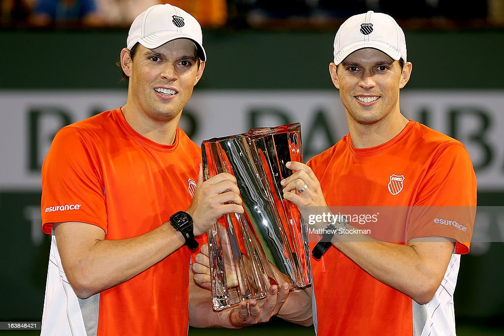 Bob and Mike Bryan pose for photographers after defeating Treat Huey of the Philippines and Jerzy Janowicz of Poland during the doubles final of the BNP Paribas Open at the Indian Wells Tennis Garden on March 16, 2013 in Indian Wells, California.