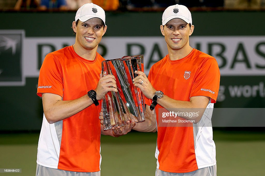 Bob and <a gi-track='captionPersonalityLinkClicked' href=/galleries/search?phrase=Mike+Bryan&family=editorial&specificpeople=204456 ng-click='$event.stopPropagation()'>Mike Bryan</a> pose for photographers after defeating Treat Huey of the Philippines and Jerzy Janowicz of Poland during the doubles final of the BNP Paribas Open at the Indian Wells Tennis Garden on March 16, 2013 in Indian Wells, California.