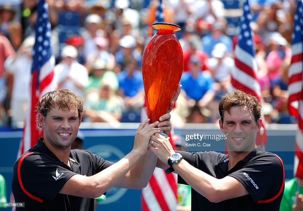 Bob and Mike Bryan pose with their trophy after defeating Gilles Muller of Luxembourg and Colin Fleming and Great Britain during the BB&T Atlanta Open Final at Atlantic Station on August 2, 2015 in Atlanta, Georgia.