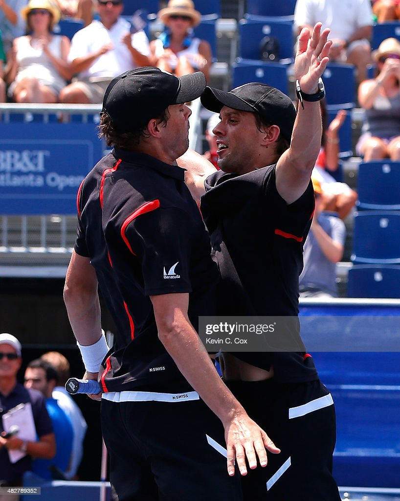 Bob and Mike Bryan react after defeating Gilles Muller of Luxembourg and Colin Fleming of Great Britain during the BB&T Atlanta Open Final at Atlantic Station on August 2, 2015 in Atlanta, Georgia.