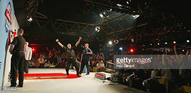 Bob Anderson of England celebrates his victory against Andy Jenkins of England during the third round of the 2004 Ladbrokescom World Darts...