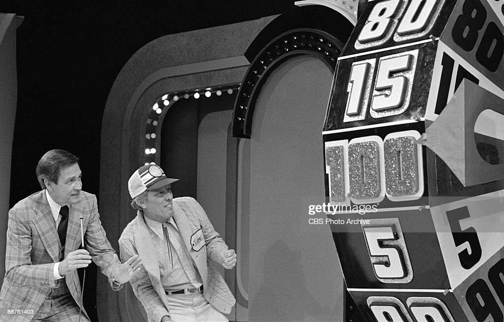 Bob Barker and a contestant named James look on as the Big Wheel spins around on the game show 'The Price Is Right' February 1978