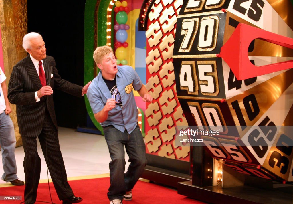 Bob Barker looks on as a contestant takes part in a game during the taping of the 34th season premiere of 'The Price is Right' at CBS Television City...