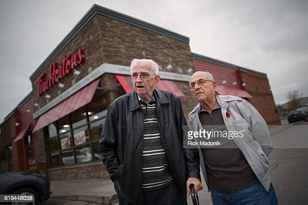 Bob Beattie and Joe Piovesan outside the Tim Horton's they visit a few times a week Visiting Woodstock Ontario to find the mood of folks in light of...