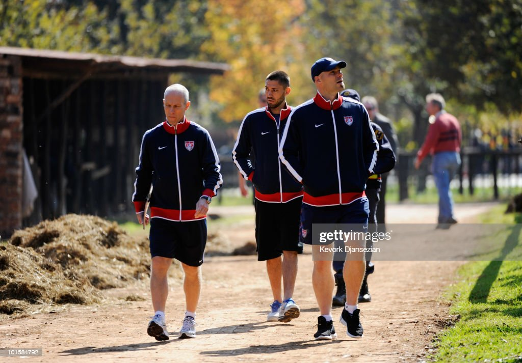 <a gi-track='captionPersonalityLinkClicked' href=/galleries/search?phrase=Bob+Bradley&family=editorial&specificpeople=685515 ng-click='$event.stopPropagation()'>Bob Bradley</a> (L) head coach of US national team goalkeeper <a gi-track='captionPersonalityLinkClicked' href=/galleries/search?phrase=Marcus+Hahnemann&family=editorial&specificpeople=593351 ng-click='$event.stopPropagation()'>Marcus Hahnemann</a> (R) and midfielder <a gi-track='captionPersonalityLinkClicked' href=/galleries/search?phrase=Clint+Dempsey&family=editorial&specificpeople=547866 ng-click='$event.stopPropagation()'>Clint Dempsey</a> walk down a pathway at Irene Farm to a news conference on June 3, 2010 in Irene near Pretoria, South Africa. US will face England in their 2010 World Cup opener on June 12.
