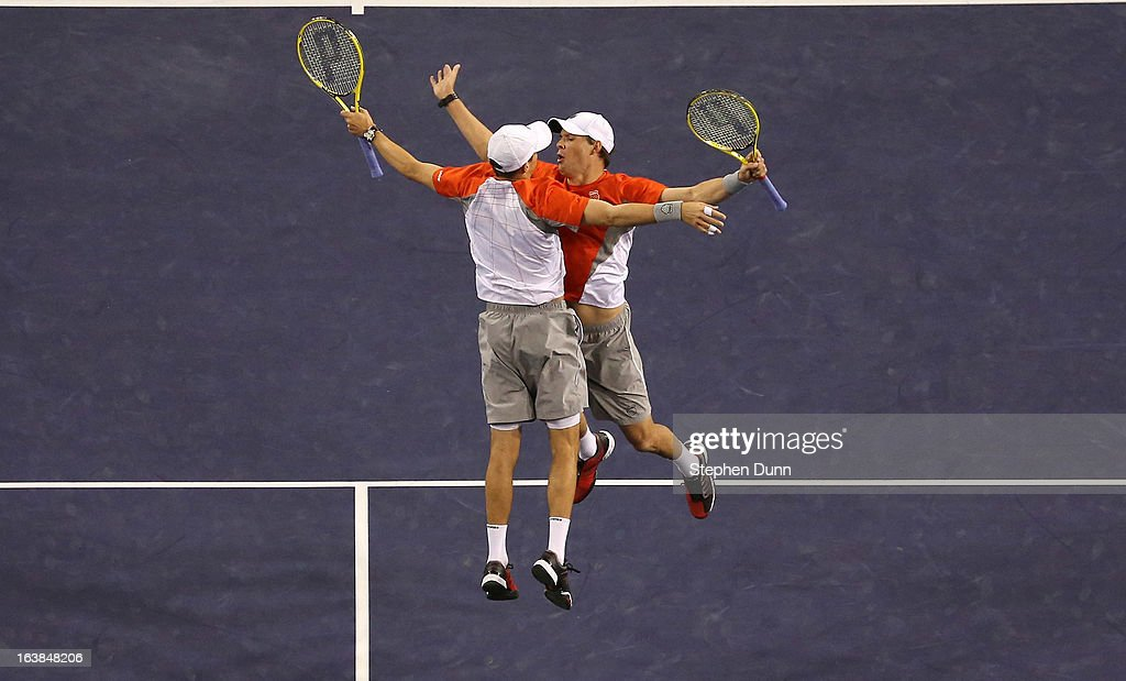 Bob Bryan (R) and Mike Bryan jump to celebrate after winning match point against Treat Huey of the Philippines and Jerzy Janowicz of Poland during the men's doubles final during day 11 of the BNP Paribas Open at Indian Wells Tennis Garden on March 16, 2013 in Indian Wells, California.