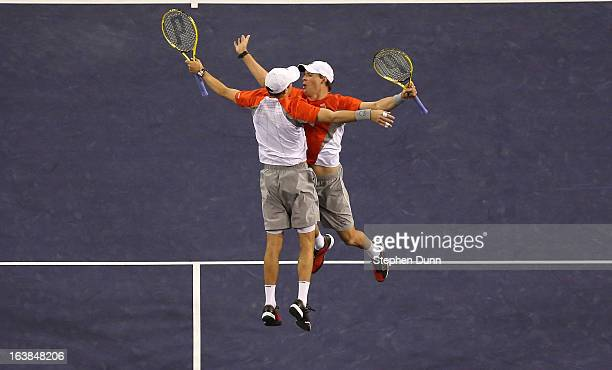 Bob Bryan and Mike Bryan jump to celebrate after winning match point against Treat Huey of the Philippines and Jerzy Janowicz of Poland during the...
