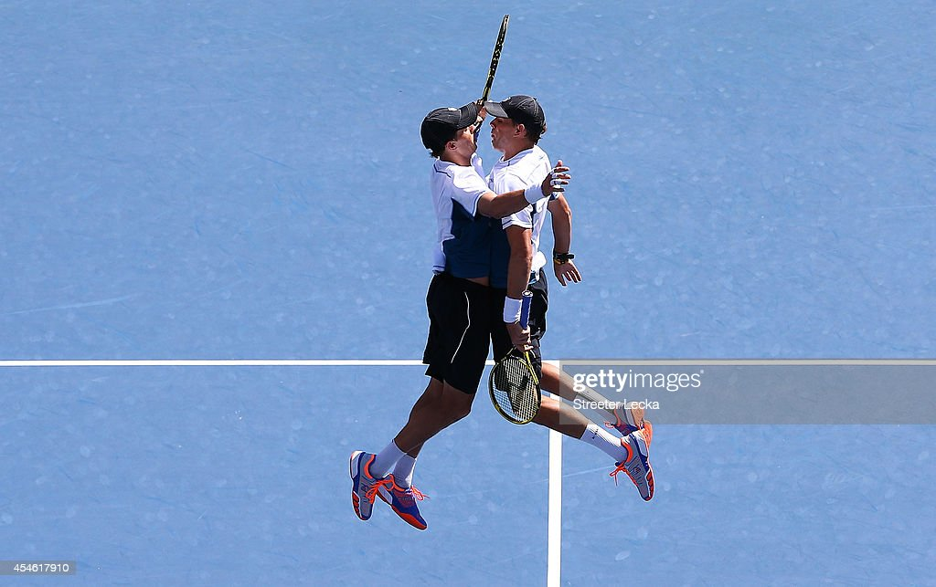 <a gi-track='captionPersonalityLinkClicked' href=/galleries/search?phrase=Bob+Bryan&family=editorial&specificpeople=203335 ng-click='$event.stopPropagation()'>Bob Bryan</a> and <a gi-track='captionPersonalityLinkClicked' href=/galleries/search?phrase=Mike+Bryan&family=editorial&specificpeople=204456 ng-click='$event.stopPropagation()'>Mike Bryan</a> of the United States celebrate after defeating Scott Lipsky and Rajeev Ram of the United States during their men's doubles semifinal match on Day Eleven of the 2014 US Open at the USTA Billie Jean King National Tennis Center on September 3, 2014 in the Flushing neighborhood of the Queens borough of New York City.